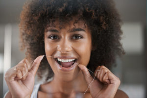 woman flossing smiling