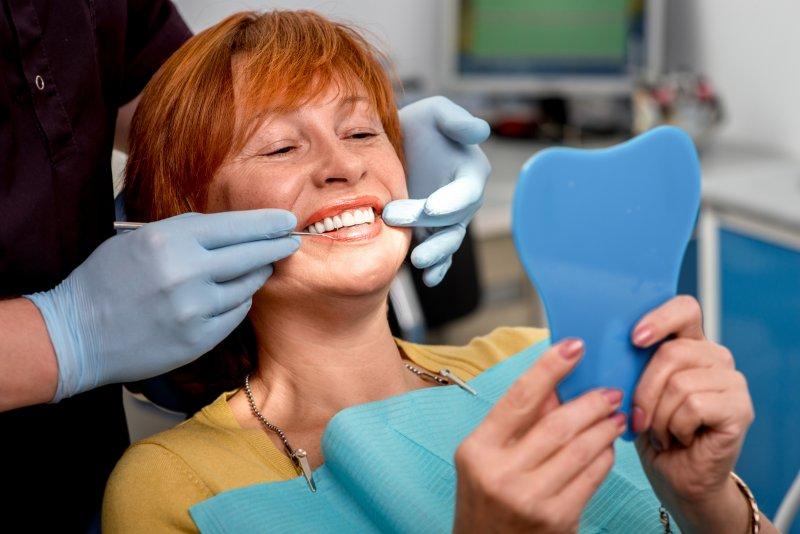 Woman with dental implants in La Porte